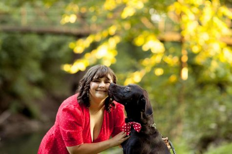 Cancer survivor Winter Racine with her service dog Aladdin.